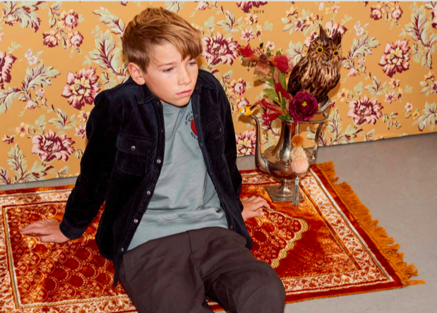 boy sitting on a carpet